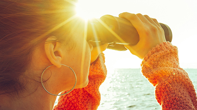woman looking through binocular