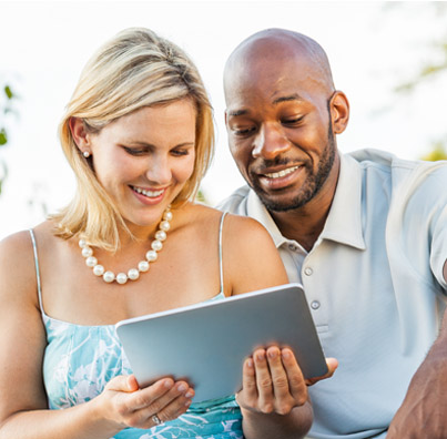 Woman and man looking at tablet